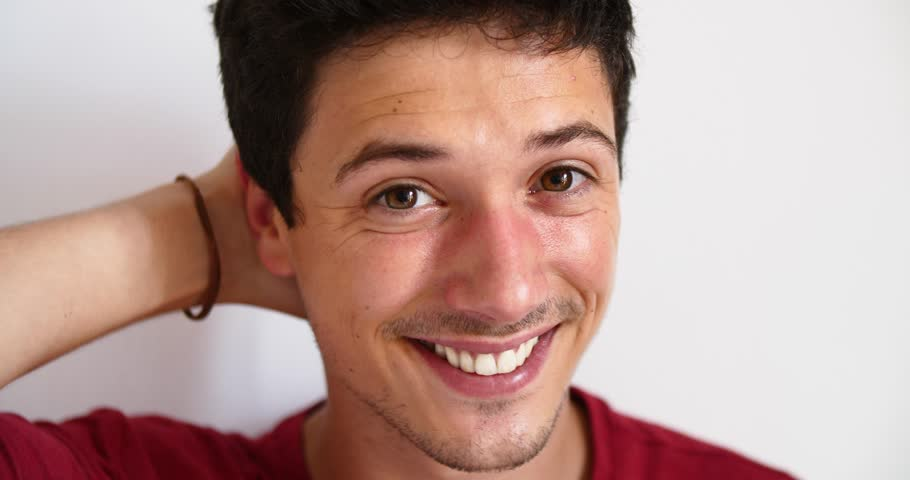 Happy young man concept smiling at camera confidence successful relaxed male white teeth healthy confident male attractive portrait close up happiness full plump lips perfect straight seductive | Shutterstock HD Video #1013640968