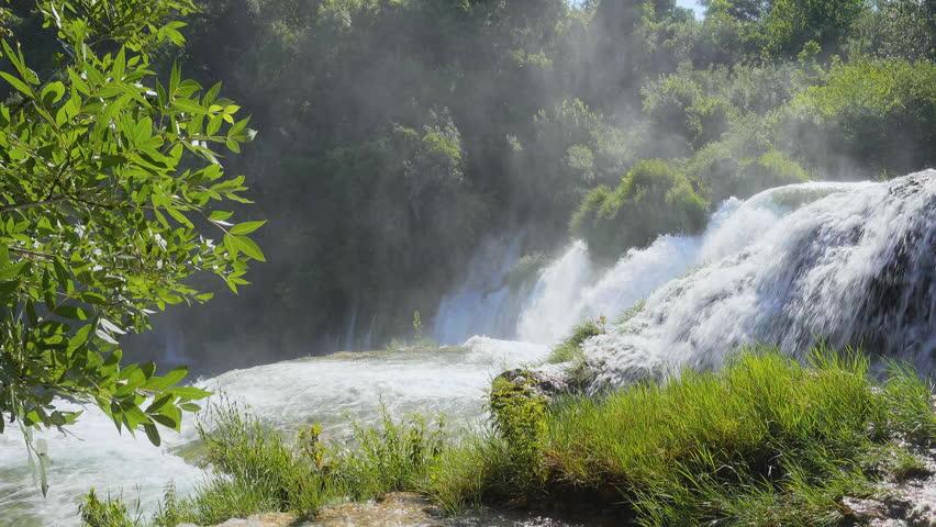 Skradinski buk the most unusual waterfall in Krka National Park. Location place Skradin resort (Lozovac), Croatia, Europe. Scenic footage of travel destination. Beauty of earth. Shooting in 4K video. | Shutterstock HD Video #1013644778