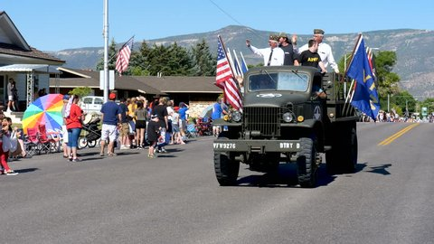 MORONI, UTAH, USA - July 4, 2018: Veterans of Foreign Wars ride in vintage WWII vehicle in small town 4th of July parade