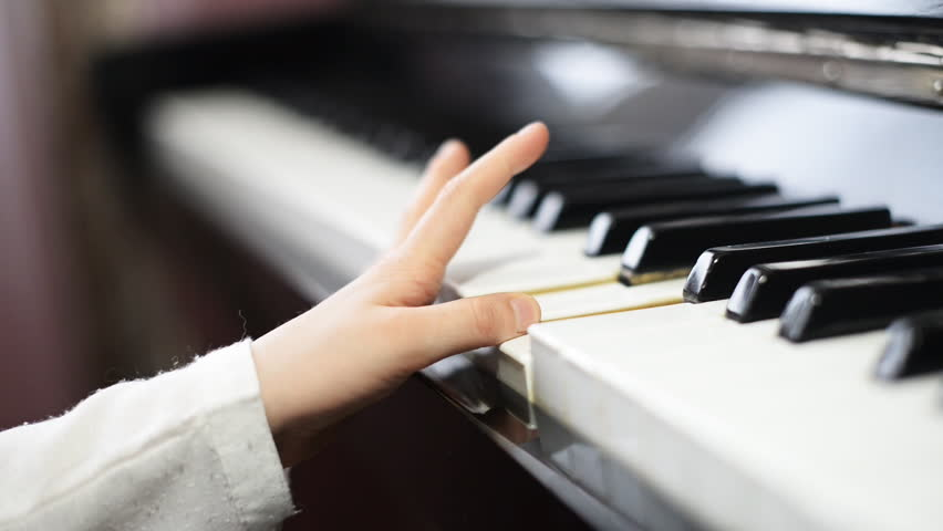 Child learning to play the piano. | Shutterstock HD Video #10136597