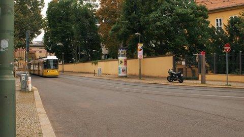 Berlin, Germany - September 1, 2017: New yellow tram moves along the street. Moved shot filmed in 4k UHD 2160p