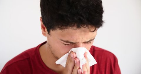 4k sick young man coughing ill flu fever  sick handsome male cough  blow nose cold winter headache sore throat