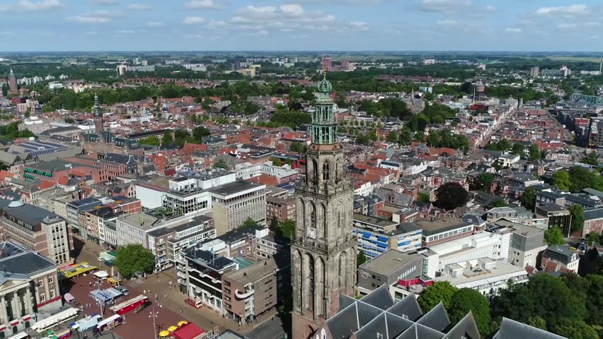 Aerial footage of Martinitoren the highest church steeple in city of Groningen Netherlands and bell tower of Martinikerk it is located at the north-eastern corner of the Grote Markt Main Market Square