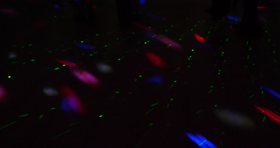 Abstract disco and laser lights at dance floor background | Shutterstock HD Video #1013725598