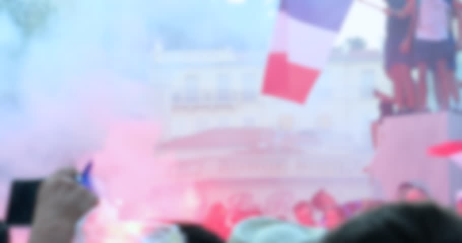 Blurred Background Of Crowd Of French Supporters With Tricolor Flag Celebrate In The Street After Winning The World Cup - DCi 4K Resolution | Shutterstock HD Video #1013738108