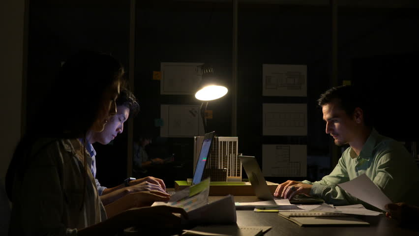 Business people team hard working to late night at office. Employee work overtime. Concept of relaxation is not enough and busy meeting room.   Shutterstock HD Video #1013803838