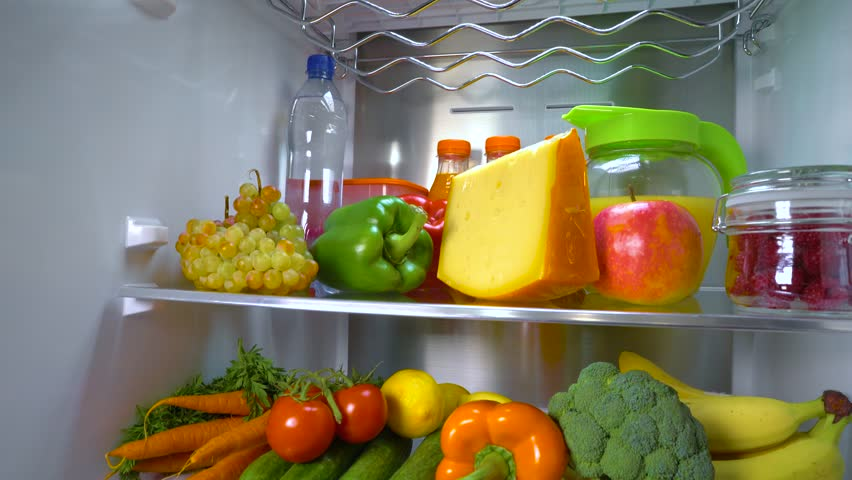 Open refrigerator filled with food. Healthy food.   Shutterstock HD Video #1013810738
