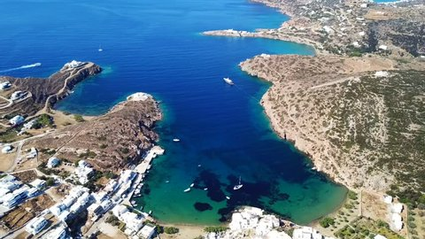 Aerial drone bird's eye view video from picturesque bay and village of Faros, Sifnos island, Cyclades, Greece