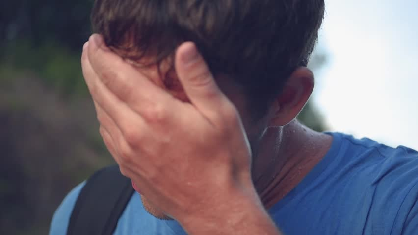 The athlete's man, tired and covered with sweat, wipes his face with his hand, breathes heavily. Slow motion, HD, 1920x1080 #1013846408