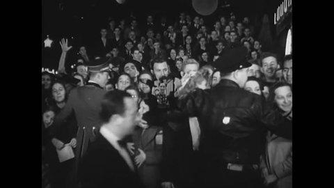 CIRCA 1940 - Moviegoers attend the premiere of a film at the Pantages Theater in Hollywood, California and a scientific motion picture camera.