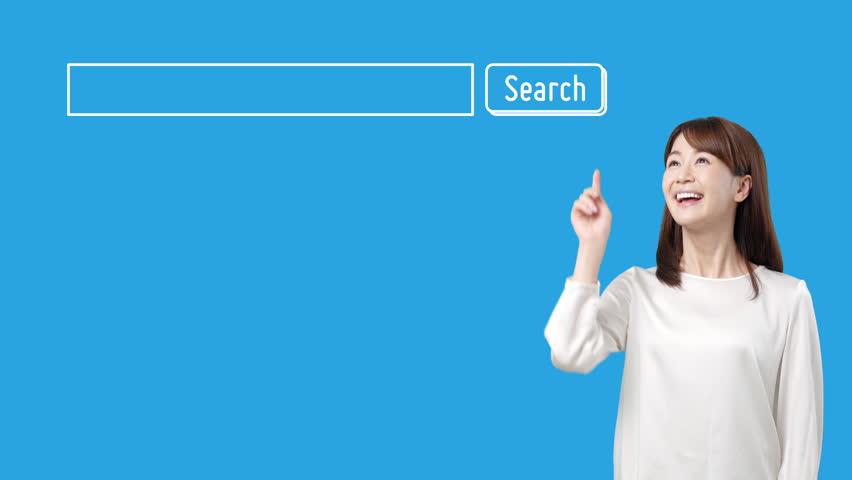 Young asian girl pushing searching button.