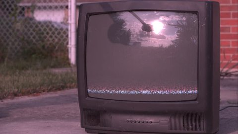 TV hit by sledge hammer explodes in slow motion