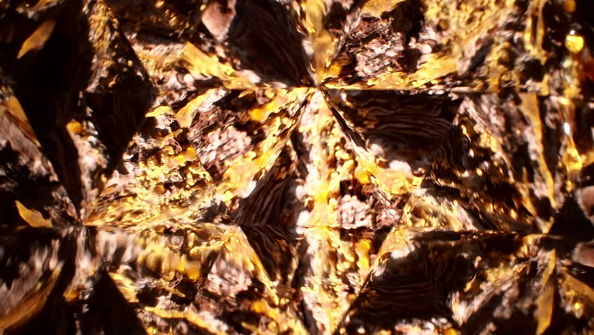 Tree resin on the bark of a pine tree filmed through a kaleidoscope - concept