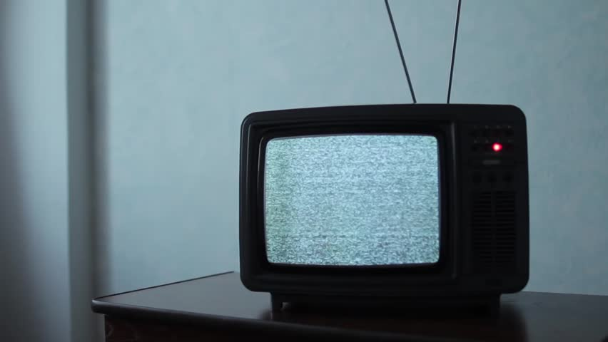 Static noise on a vintage TV set in a dark room | Shutterstock HD Video #1013914838