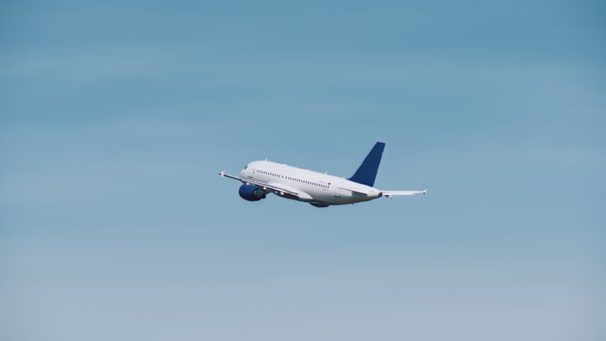 White aircraft with a blue tail took off from the airport and is gaining height | Shutterstock HD Video #1013923328