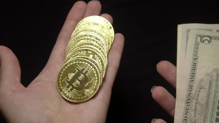 Weighting Bitcoins and American Dollars Banknotes. National Currency of the USA. Digital Currency and Traditional Cash Money   Shutterstock HD Video #1013939408