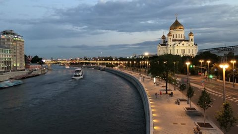 Embankment of Moscow River near the Cathedral of Christ the Savior at night. Car traffic timelapse. Moscow, Russia.