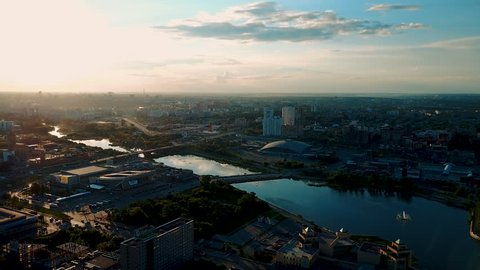 Drone flight over the main embankment of the river Miass, sunny evening in the capital of the Southern Ural, Chelyabinsk, Russia