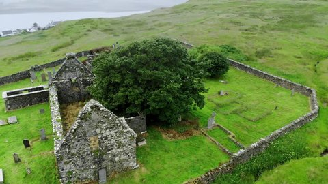 Ruins of an old church and cemetery in Scotland - aerial drone footage