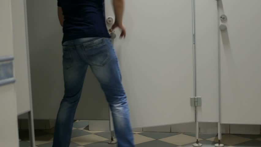 Male man runs into the toilet cabin in public wc | Shutterstock HD Video #1014046748