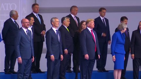2018 - international dignitaries pose for a group photo at the NATO summit in Brussels, Belgium.