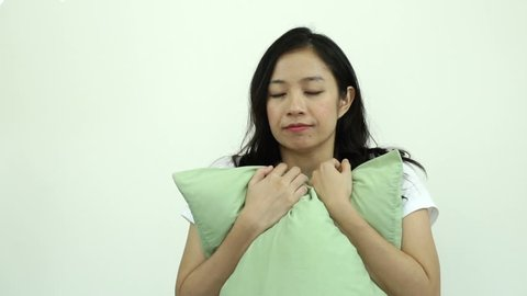 Asian woman hug soft feather pillow smile, happiness slow motion