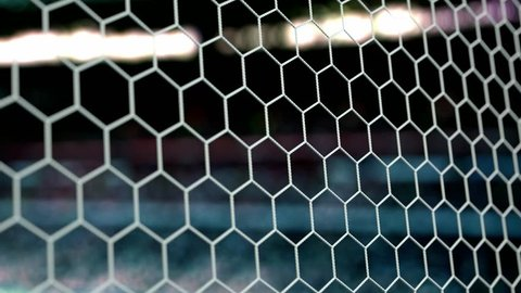 Beautiful Soccer Ball flies into Goal Net in Slow Motion. Football 3d animation of the Goal Moment. 4k