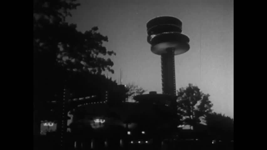 CIRCA 1960s - As nighttime comes to the 1964 New York World's Fair, pavilions are lit up beautifully for the dark.