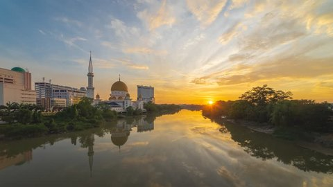 Beautiful sunrise time lapse at the Royal Mosque with the reflection by the Klang river, Selangor, Malaysia. Full HD 1080p.