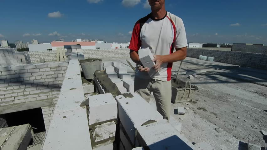 Construction, builder, masonry brick wall.