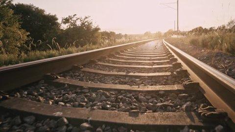 Walking on railway tracks in a beautiful sunset.