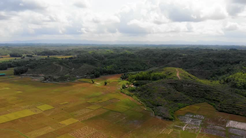 Aerial time lapse of clouds moving over green hills taken from Cox's Bazaar, Bangladesh