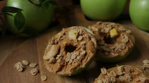 Simple and delicious sliced apple rings topped with peanut butter and granola.