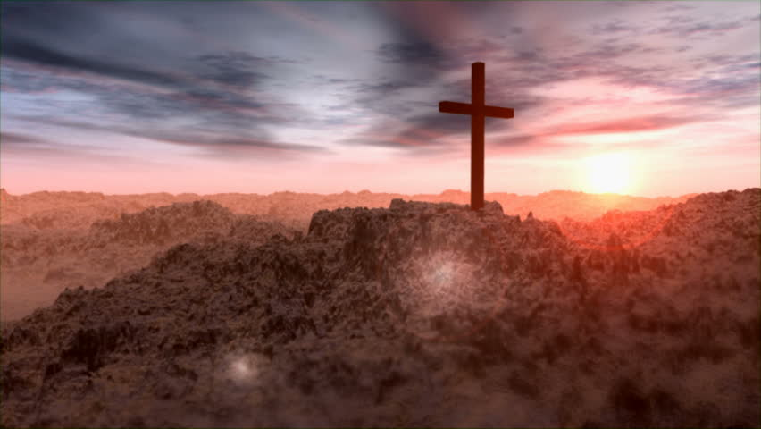 Pan of Cross in desert landscape at sunrise
