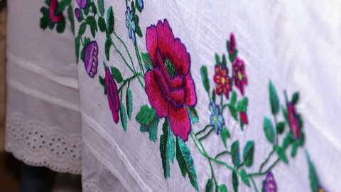 Women's clothing with brightly embroidered flowers. Home embroidery.
