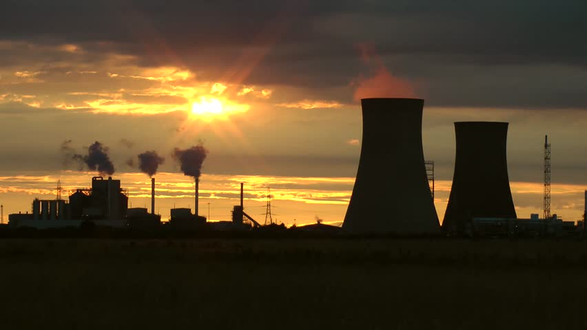 Petroleum oil refineries cooling towers with steam shot over corn wheat field and at sunset.  Filmed  in England, Yorkshire.  | Shutterstock HD Video #1014263918