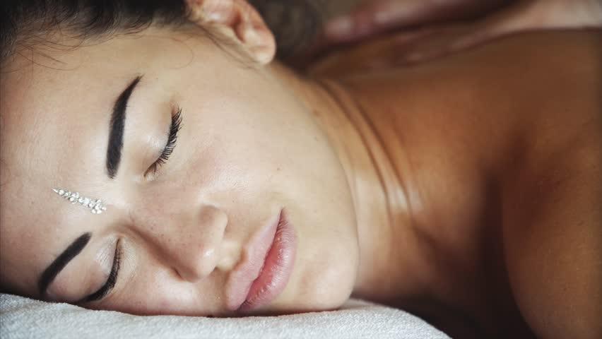 Spa hotel, woman is taking a massage. Closeup.