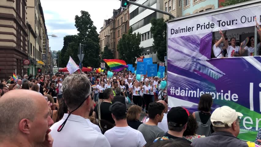 Stuttgart, Germany - July 28, 2018: Participants are celebrating Christopher Street Day, the gay lesbian pride festival in Stuttgart, Germany on the truck of the Daimler company