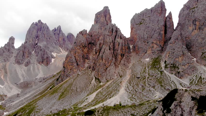 Aerial view of the Dolomites Mountains, Italy. Rocky mountain in Italian Dolomites. Paths and trails on the mountain. Via ferrata routes. Big walls in the mountains. Mountains ridge and peaks.