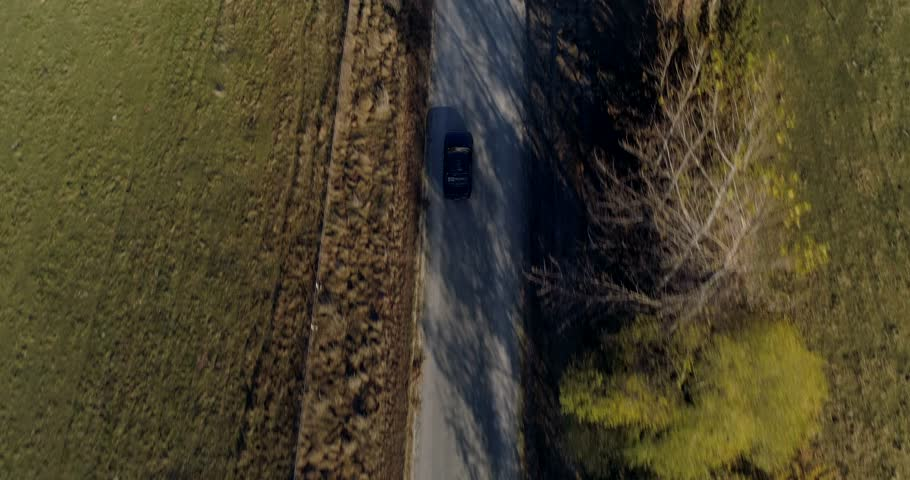 Aerial top down shot following a car in New Zealand in Autumn