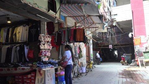GUANGZHOU, - OCTOBER 19: Clothes shop in Xian Urban Village slums of Guangzhou. October 19, 2017 in Guangzhou, Guangdong, China