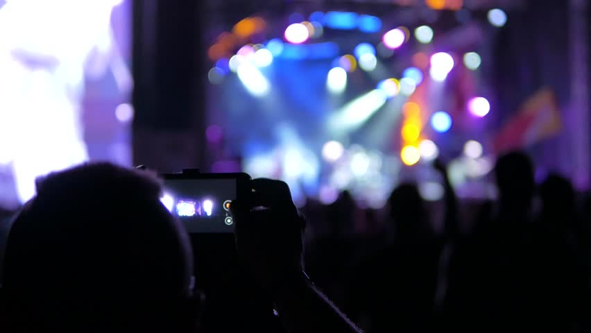Man filming a concert | Shutterstock HD Video #1014356768
