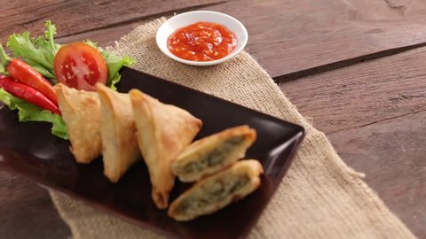 samosa or sambusa triangle fried or baked dish with a savoury filling. indian food