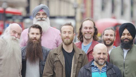 Portrait of a group of men in the city with beards looking to camera