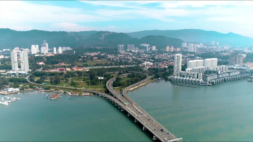 Aerial view of traffic at first Penang Bridge, Malaysia. The Penang Bridge, route, is a 13.5-kilometre dual carriageway toll bridge and controlled-access highway in the state of Pen