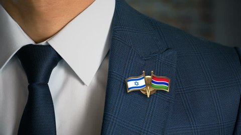 Businessman Walking Towards Camera With Friend Country Flags Pin Israel - Gambia
