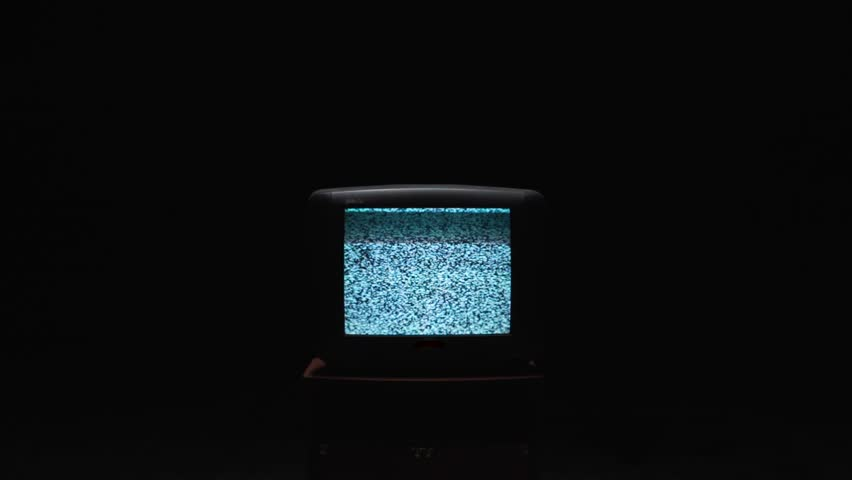 TV screen on at night with a white noise. Stock. Static noise on the old TV screen in the dark