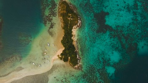 Tropical lagoon with turquoise water and white sand. Beautiful beach. Tropical bay in El Nido. Aerial view: bay and the tropical island. Aerial video. Seascape: mountains, ocean. Philippines, El Nido