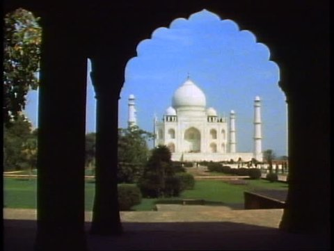 AGRA, INDIA, 1982, The Taj Mahal, framed in a scalloped archway