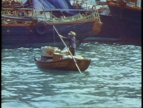 HONG KONG, CHINA, 1982, Aberdeen, floating city, boat people, old woman oars POV